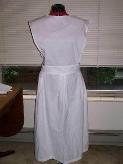Plain apron with bib, c. 1917-19.