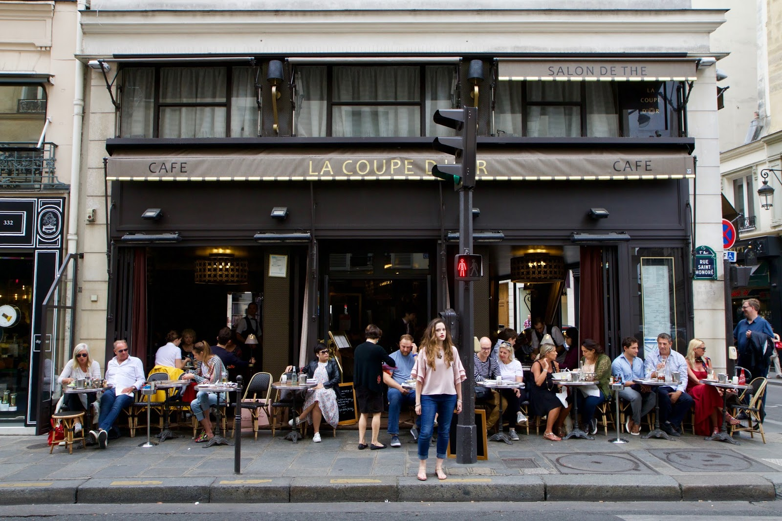 Fashion blogger Kathleen Harper outside a cafe in Paris France