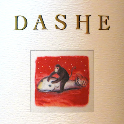 Wine label depicticting a monkey riding a whale.