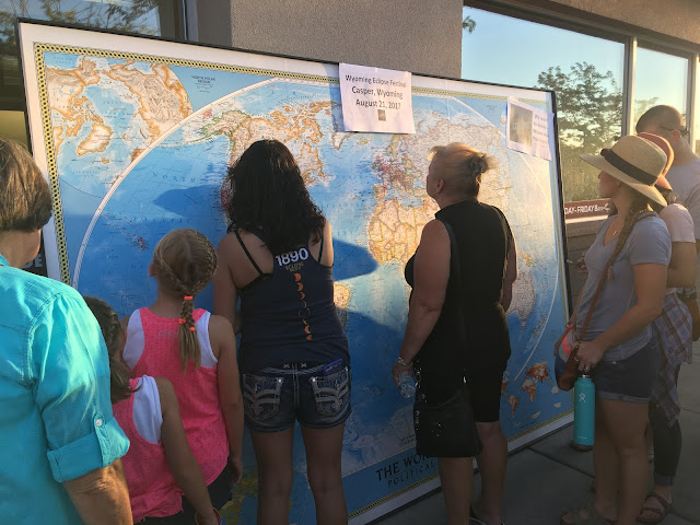 Giant map, people in front