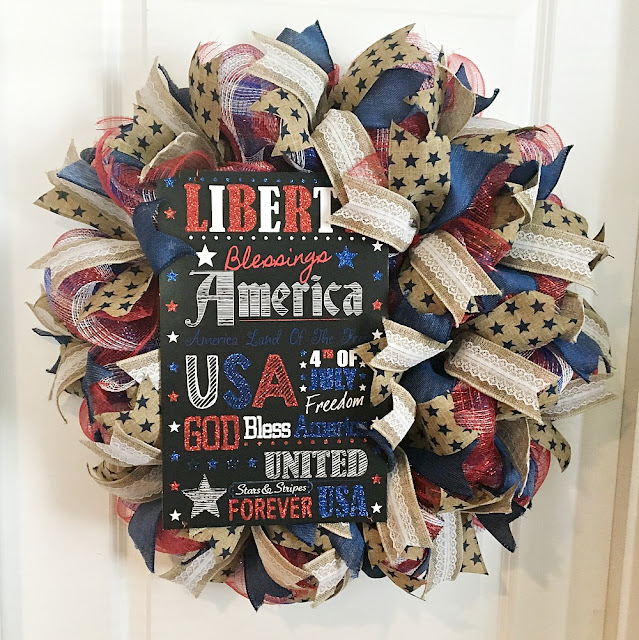 Vintage Paint and more... a patriotic wreath made with red, white, and blue deco mesh and lengths of beautiful wire edged ribbon along with a patriotic sign