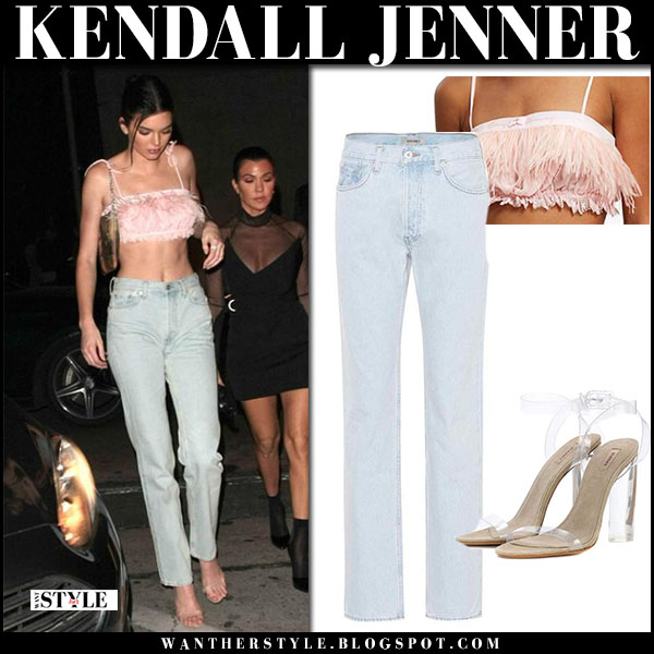 Kendall Jenner in pink feather bralette top and jeans yeezy model street style february 18