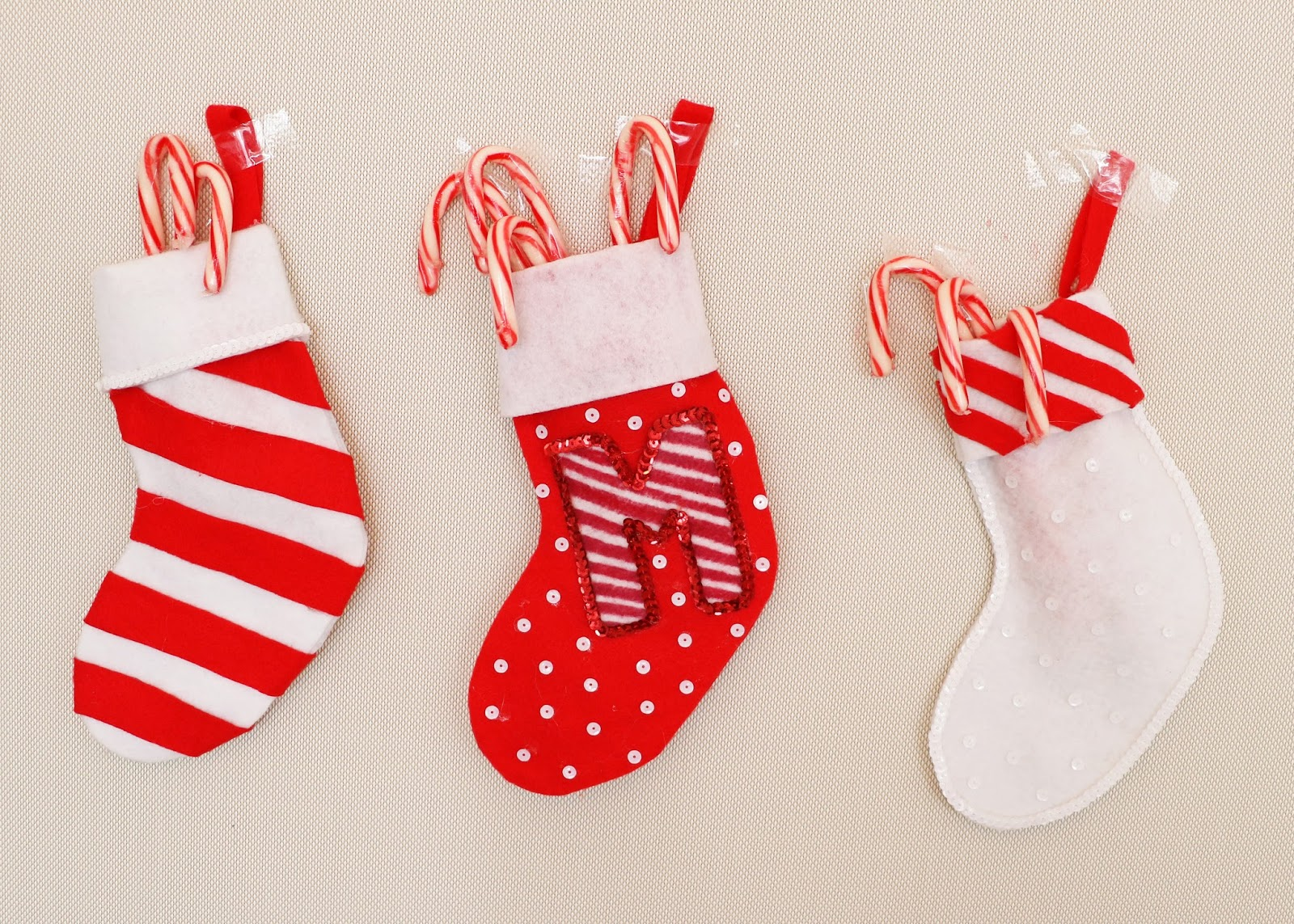 Cute Christmas stockings inspired by Candy Canes! Click through for full tutorial