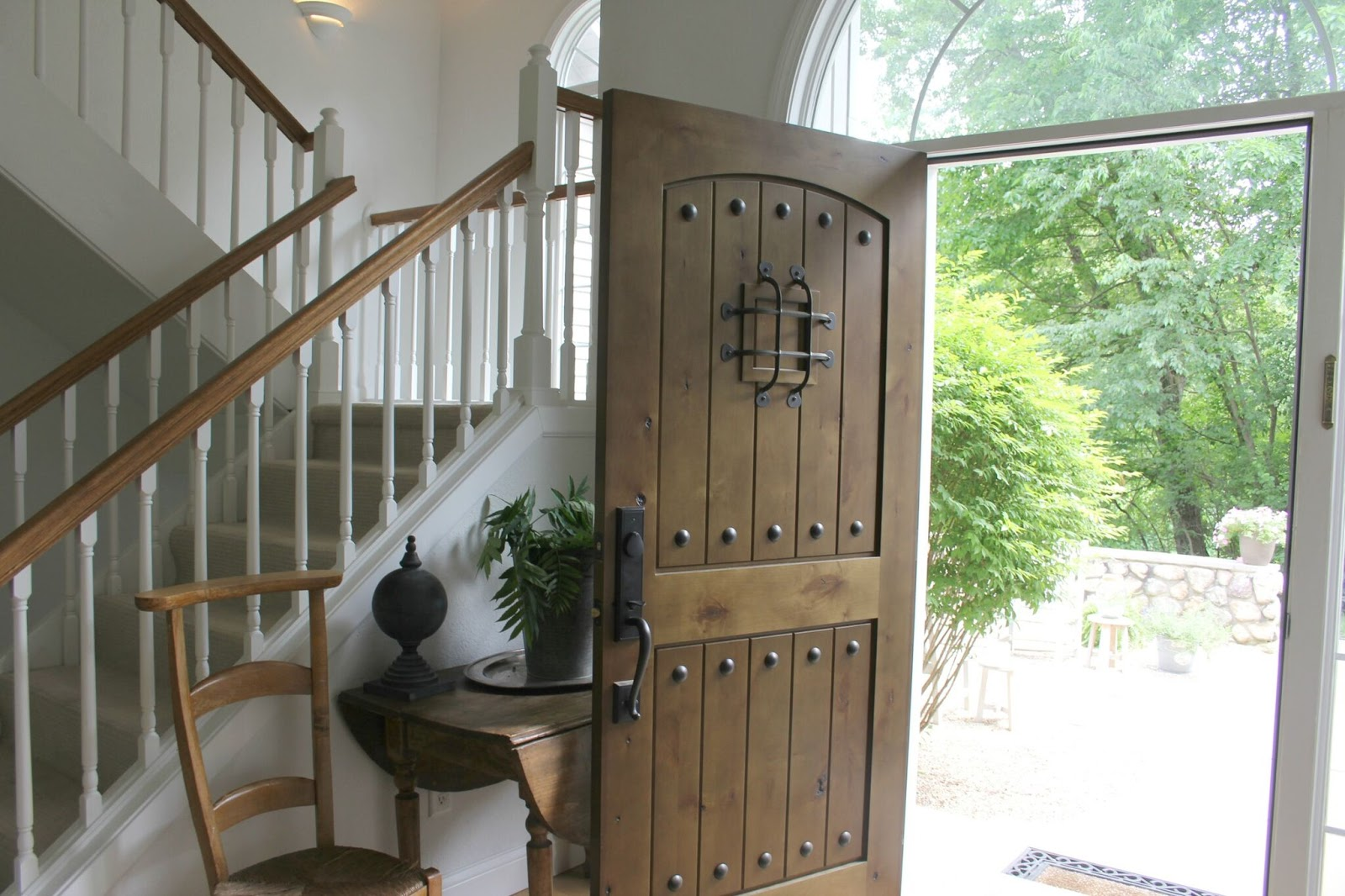 Pretty knotty alder door with speakeasy and front entry - Hello Lovely Studio