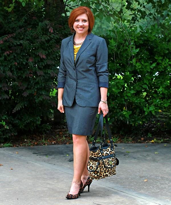 grey business suit with leopard pumps