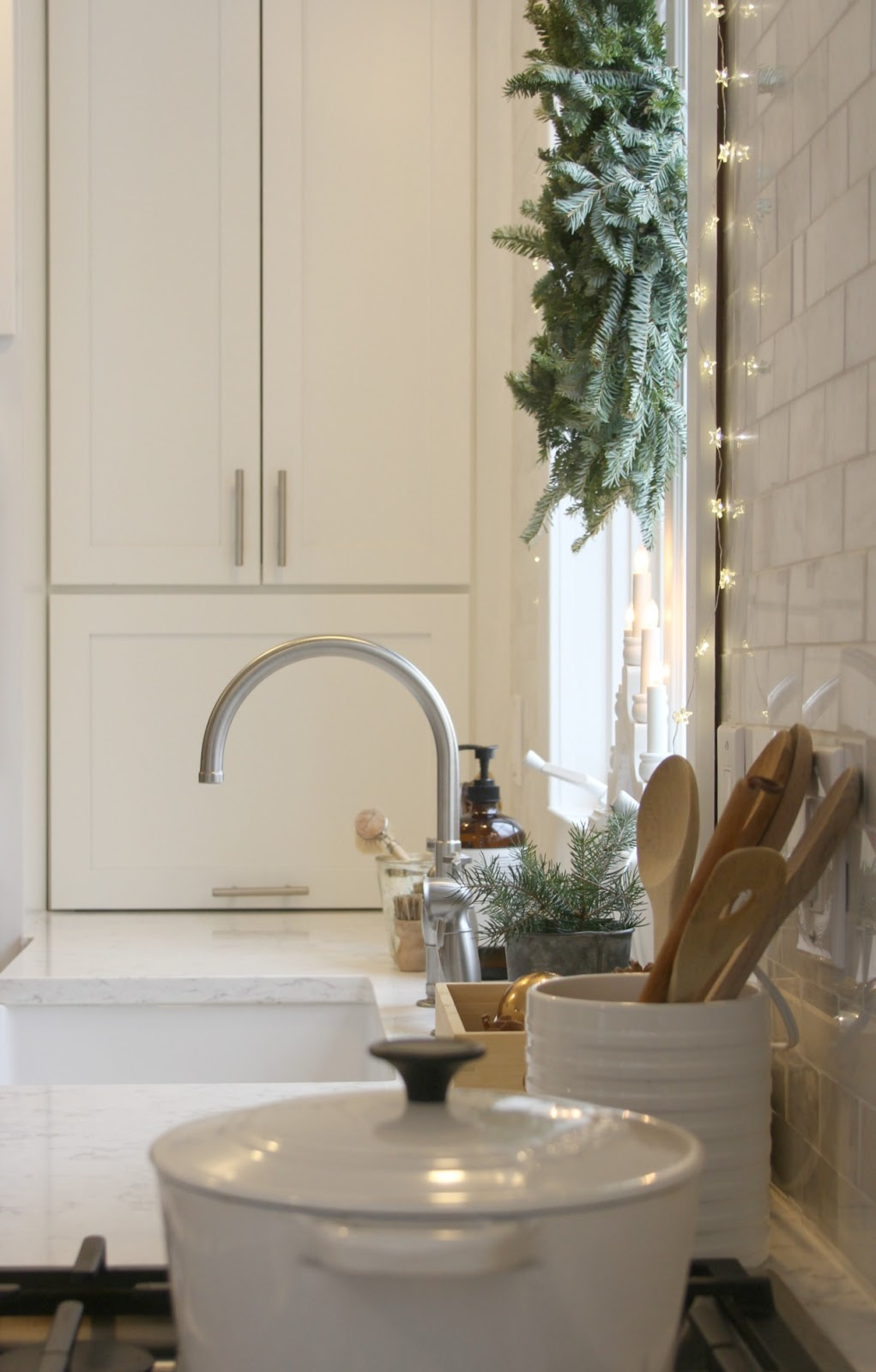 White Shaker style kitchen with Christmas decor - Hello Lovely Studio. Come be calmed by How to Freak Less About Holidays, Decorating and Gifts as well as Entertaining.