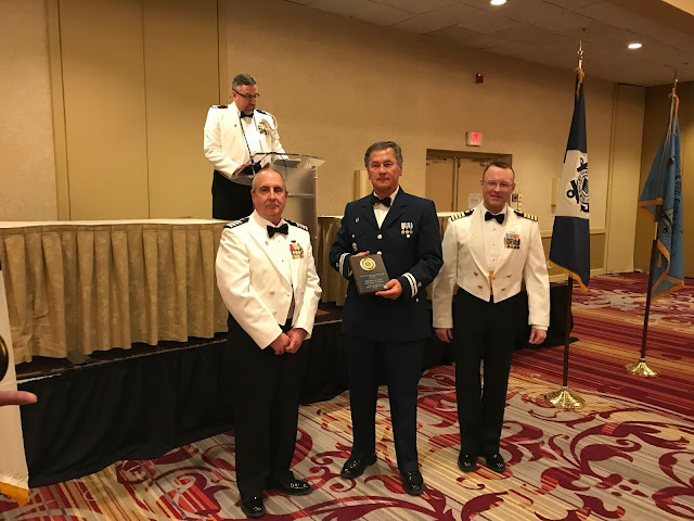 """Flotilla 16-07 Commander Basil Iwanyk (center) accepts the """"William Ross McDonald Award"""" which is awarded to the flotilla in the 5th Northern District that has the most points in public education in 2017."""