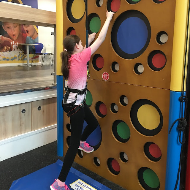 Sasha on climbing wall