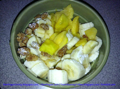 bowl-of-fruit-made-with-mangoes-bananas-dried-mulberries-prunes