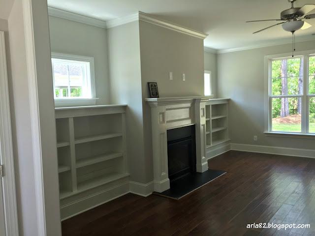 craftsman family room fireplace built-in bookshelves