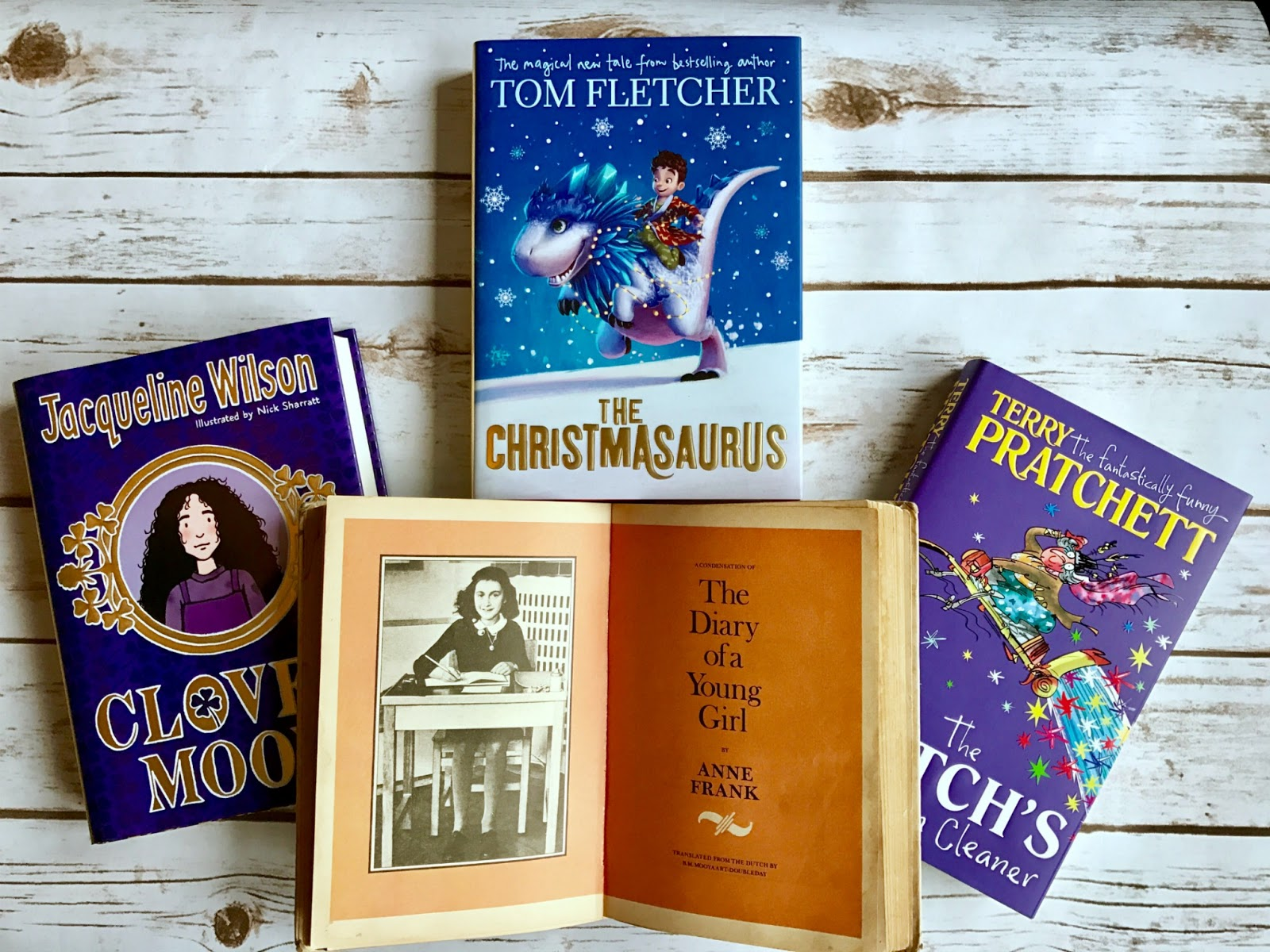 diary of a young girl by anne frank, Clover Moon by Jacqueline Wilson, Christmasaurus by Tom Fletcher, and The Witches Vacuum Cleaner by Terry Pratchett