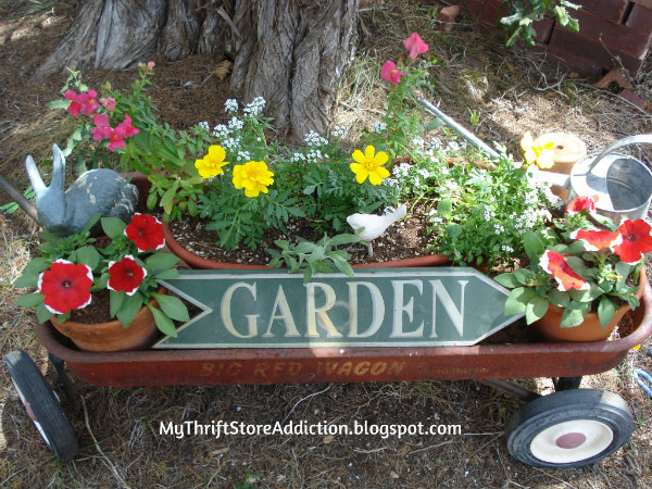 Little Red Wagon Garden and Repurposed Sign mythriftstoreaddiction.blogspot.com Vintage red wagon garden for summer
