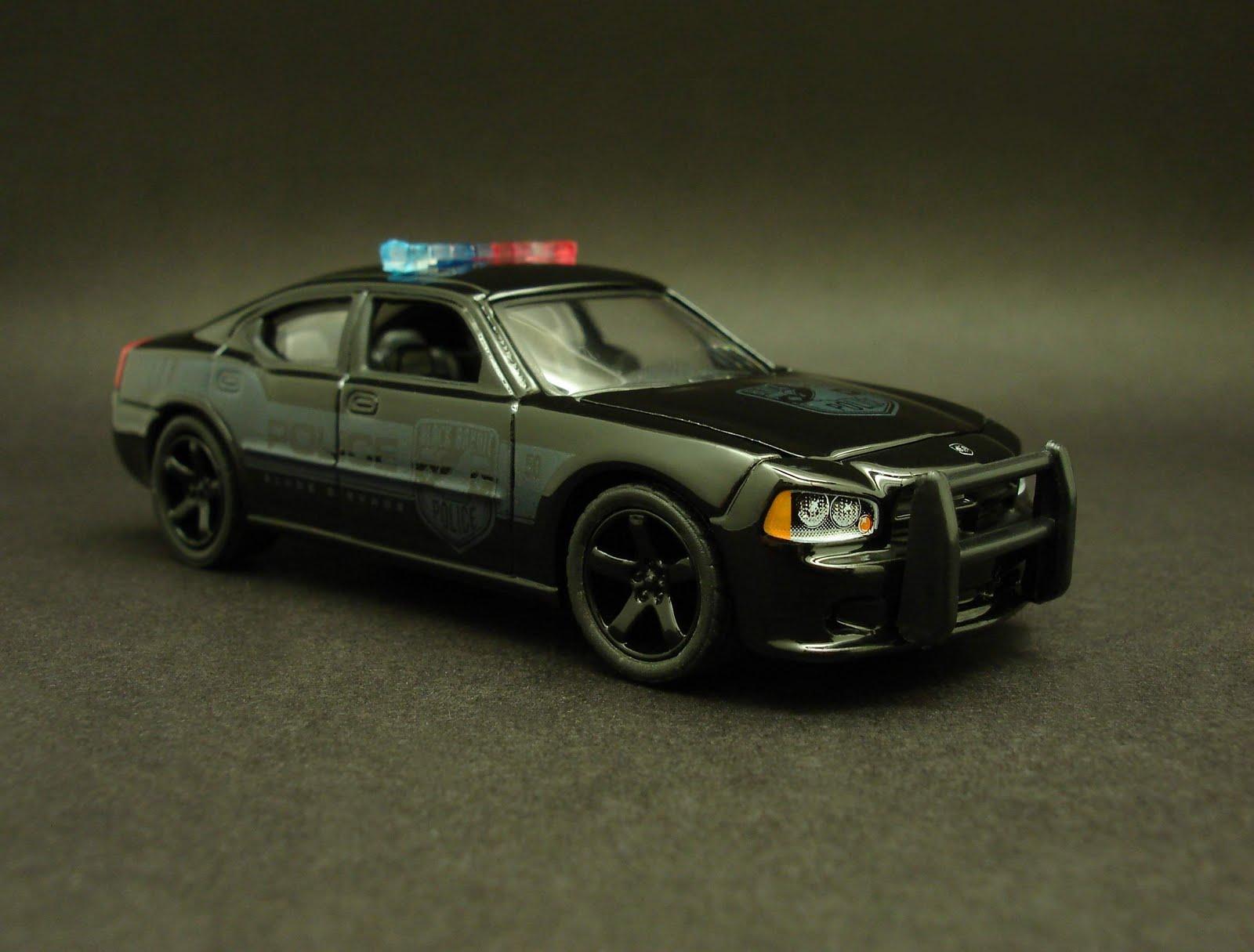 Diecast Hobbist 2006 Dodge Charger Black Bandit Police Car
