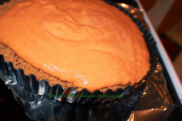 this is a removable tart bottom pan with a pecan crust baked in it with a pumpkin custard pie filling. This pumpkin pie tart is creamy and decadent. The pan with the removable bottom makes it easy to take the pie out and stay firm. This pumpkin custard tart is made with just a few ingredients and easy to make.