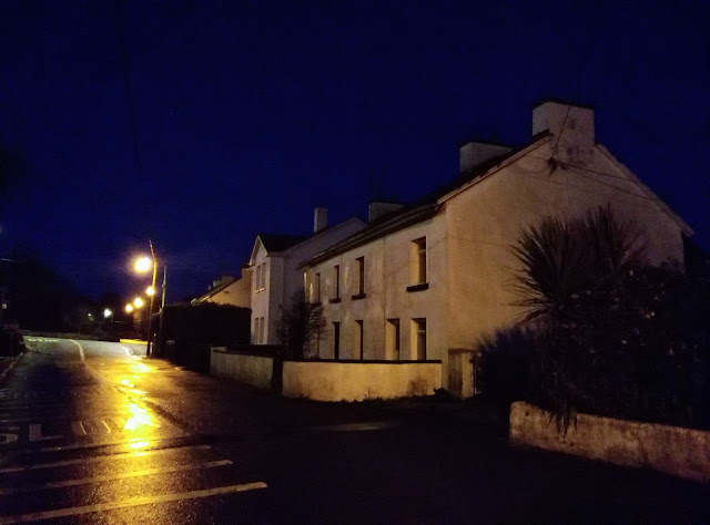 a house in the dark, street lights