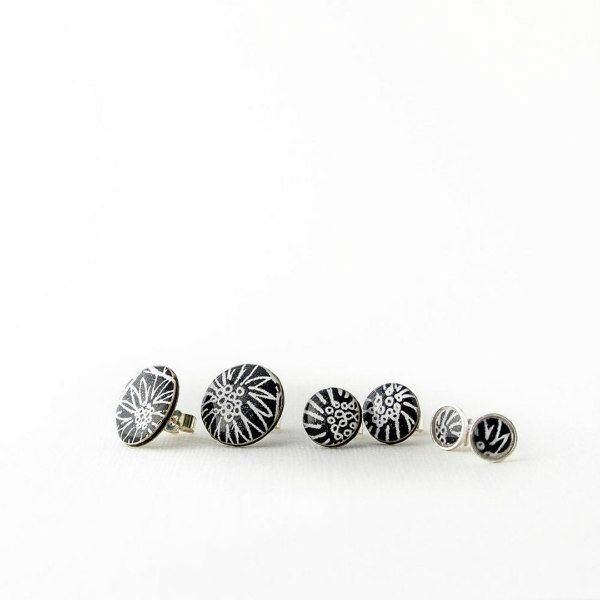 Circular sterling, black and white printed paper, and resin stud earrings in three sizes