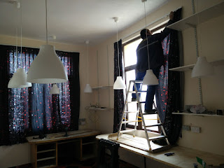 Bekir hanging the curtains