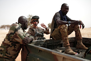 Operation Barkhane; French soldier interacting with Nigerien troops