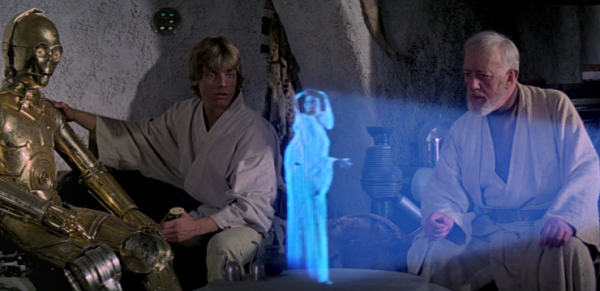 C-3PO, Luke and Obi-Wan Kenobi watch the hologram of Princess Leia