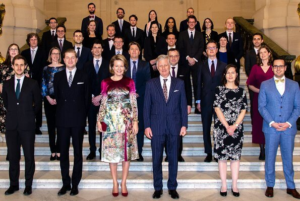 Queen Mathilde wore Etro printed satin midi dress and Natan red suede pumps, and she carries Natan suede clutch. Crown Princess Elisabeth