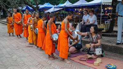 Alms-giving ceremony in Luang Prabang