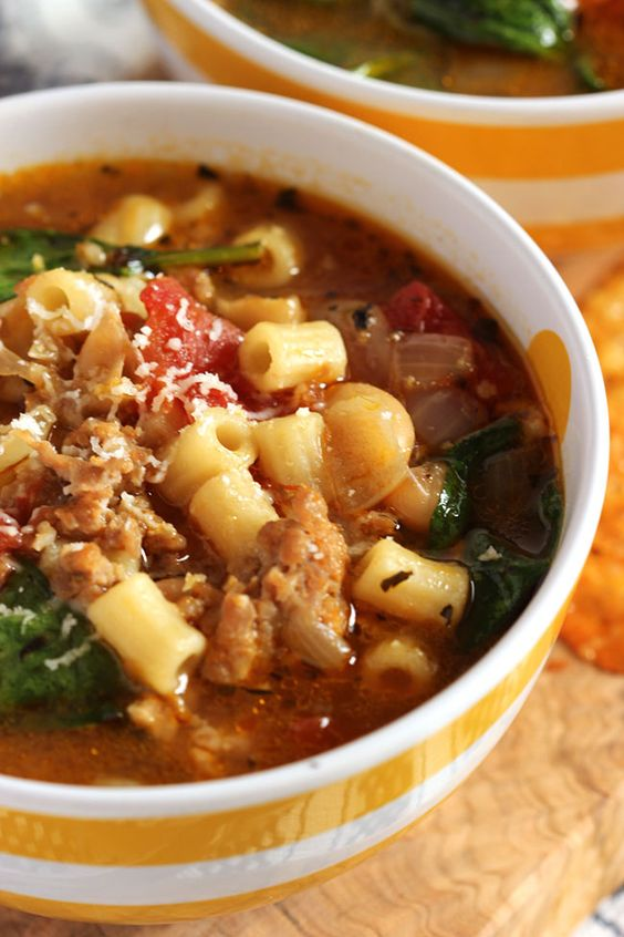 The easiest and most flavorful weeknight dinner ever, this Italian Sausage Soup with White Beans and Spinach is on the table in less than 30 minutes using a few pantry staples.  Healthy and hearty, this one is on regular rotation at my house.