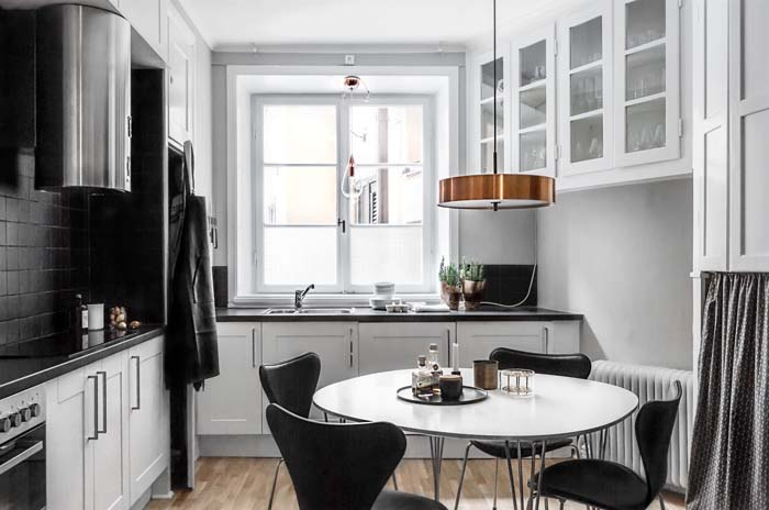 A newly renovated kitchen in Stockholm with a black and white theme featuring copper lighting accents. Via Fantastic Frank. & 9 Adorable Scandinavian Kitchens | Poppytalk