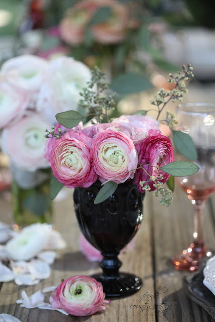 Vintage inspired goblet with ranunculus on weathered table