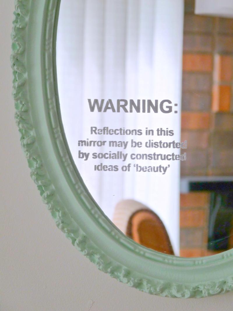 Feminist stenciled mirror