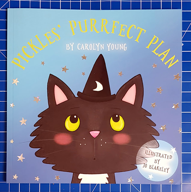 Front cover depicting cat wearing wizard's hat Pickles' Purrfect Plan by Carolyn Young Children's Book Review