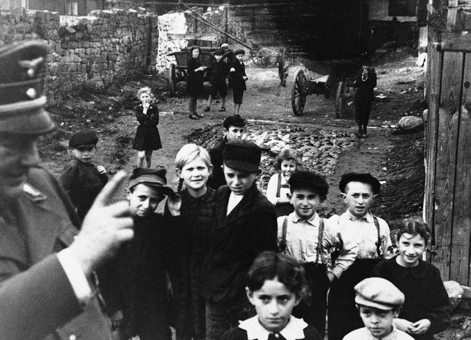 A German Army officer lecturers children in a ghetto in Lublin, German-occupied Poland, on December 1940, telling them