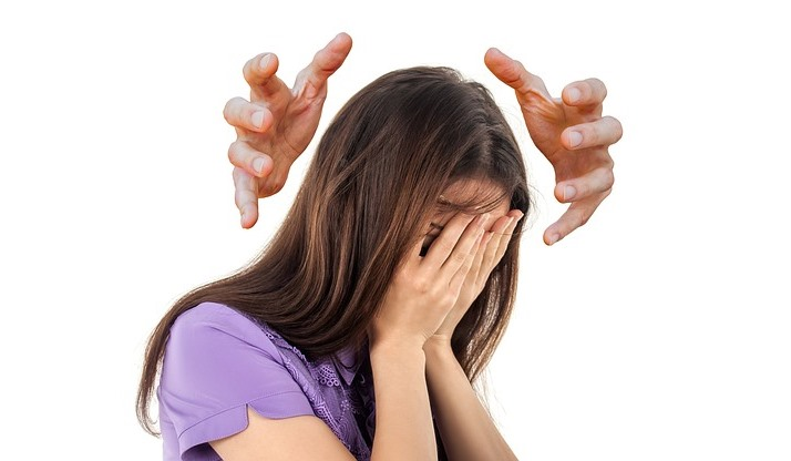 Crushing Hands of Little Stresses Closing In On a Woman's Head Pixibay Image