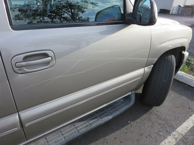 Vandalism on Chevy Tahoe before repairs & paint at Almost Everything Auto Body