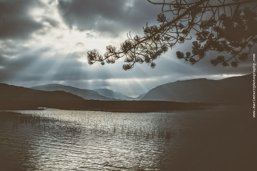 Atmospheric scenic photograph of Lough Beagh with light rays