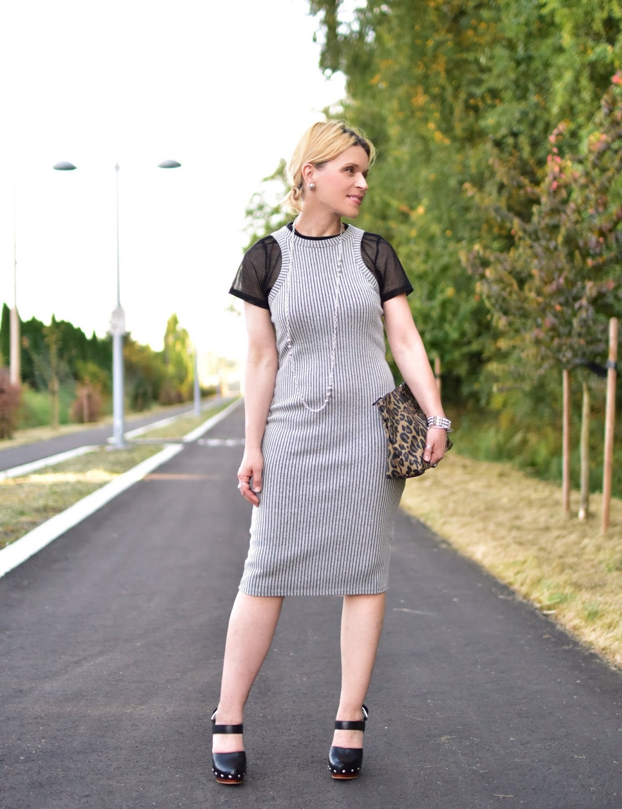 Monika Faulkner styles a tank dress with a mesh tee, platform heels, and leopard clutch