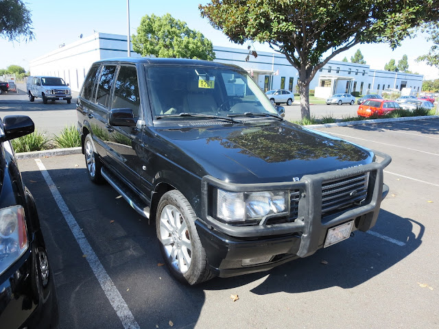 Range Rover with complete repaint including wet sand & polish at Almost Everything Auto Body.