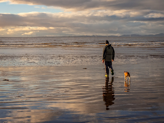 Photo of Phil and Ruby on the shore at low tide