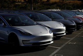 A row of new Tesla Model 3 electric vehicles is seen at a parking lot in Richmond, California, U.S., June 22, 2018. (Credit: Reuters/St) Click to Enlarge.