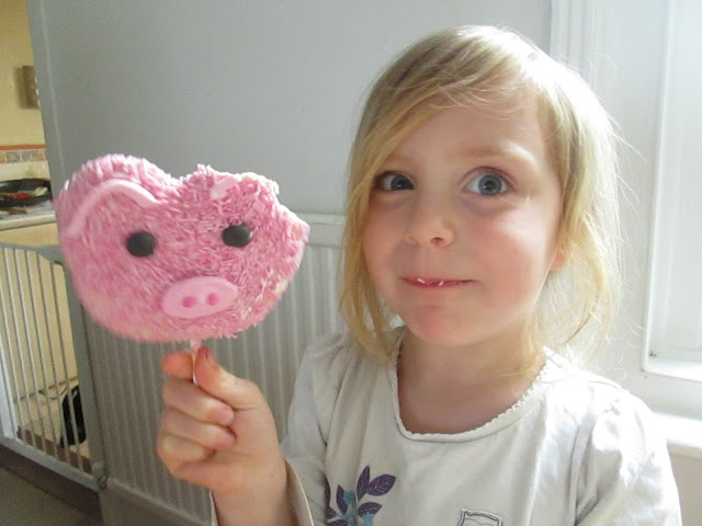 Lily enjoying her peppa pig inspired cookie lolly