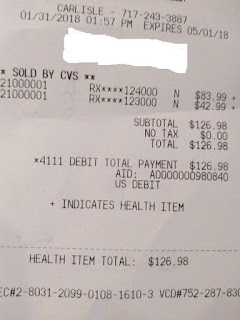 receipt for Libre, $83.99 for reader, $42.99 for sensor, total $126.98