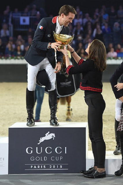Charlotte Casiraghi  present the trophies to the GUCCI Gold Cup (CSI5) podium, winner Simon Delestre of France, second Patrice Delaveau of France  and third Maikel van der Vleuten of The Netherlands prior to the 'Style and Competition' show jumping charity event benefitting 'AMADE' on day three of the Longines Paris Masters 2015 held at the Paris-Nord Villepinte Exhibition Center