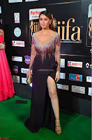 Hansika Motwani in Glittering Deep Neck Transparent Leg Split Purple Gown at IIFA Utsavam Awards 31.JPG