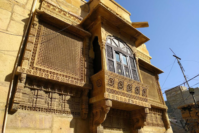 a typical yellow sandstone sculptured window in Jaisalmer
