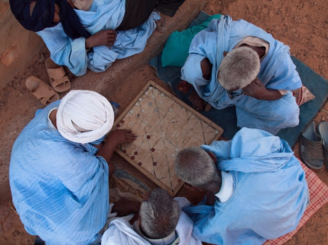 Moorish men playing Mancala a Math Game