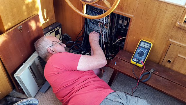 Photo of Phil working on the electrics for our new trim tab system