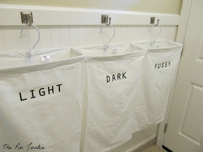 Organized laundry room diy labeled laundry bags