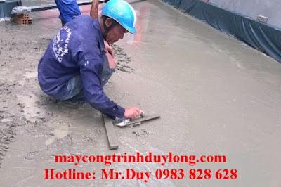 Cán mặt bê tông 100% bằng nhân công dùng thước nhôm