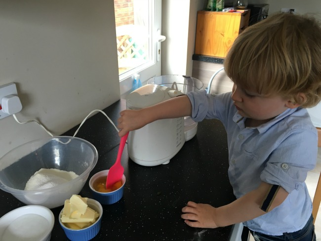 How-to-make--cup-cakes-with-a-toddler-toddler-with-spoon-in-the-eggs