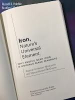 Iron, Nature's Universal Element:  Why People Need Iron and Animals Make Magnets,  by Eugenie Mielczarek, superimposed on Intermediate Physics for Medicine and Biology.