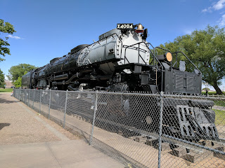 A large train sits in the middle of Holliday park in Cheyenne Wyoming